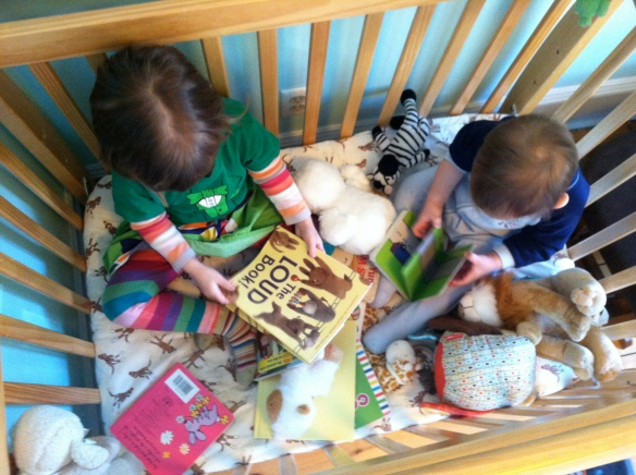 Reading in Duke's bed.